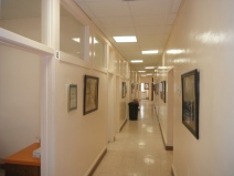 The corridoe shows the many individual rooms that have alway seen many patients - mainly poor and working class.